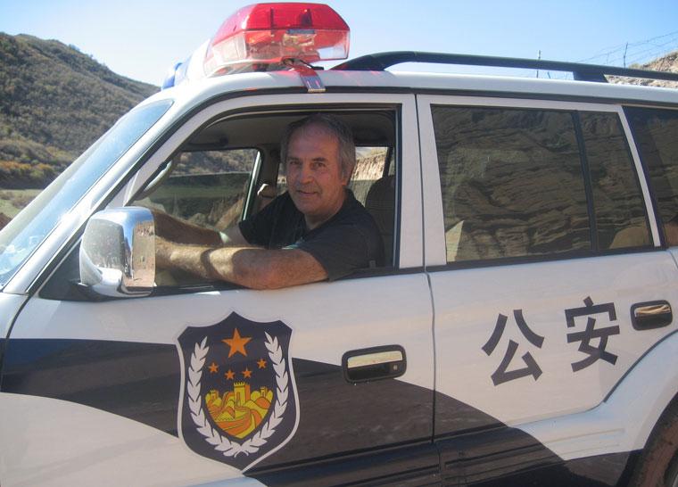 2006-09-27-Kína-Eifert-rendőrautót-vezet